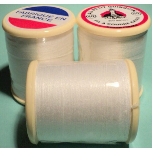 """Fil coton """"au petit quinquin"""" 200mtr blanc pour coudre à la machine à coudre et à la main."""