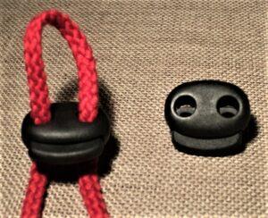 Arrêt cordon noir plat 21mm, arrêt de cordelette noir